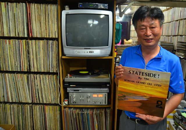 Record store owner Kim Seong-jong shows off one of his prized possessions.