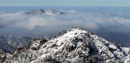 Cheonwangbong is one of mountain peaks in Jirisan National Park, covered in a blanket of snow. Jirisan changes each season, offering something for hikers who seek various aspects of the mountain's terrain
